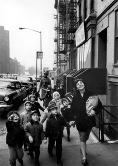 teacher edna bodden taking students on a field trip to a local grocery store, nyc, 1964  photo by burk uzzle