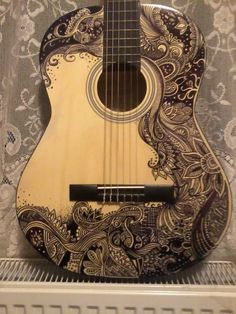 Sharpie guitar design! (also, guitar for temperature, balanced badly on a radiator) - Imgur