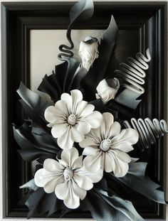 Handmade Leather Black & White Flowers.  Sku: DBKK2-44MKAG  Handmade Leather Black & White Flowers  Size: 40cm x 30cm  Frame: Solid Wood, Black Color  Colors: Black & White  Material: Genuine Leather  The Artwork is original. Each product is unique and one of a kind. Custom made specially for you.