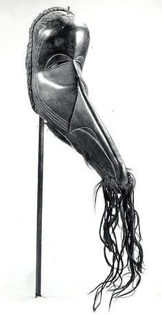 Face Mask Date: 19th–20th century Geography: Côte d'Ivoire, western Côte d'Ivoire Culture: Dan peoples Medium: Wood, hide with fur, fiber, iron, metal Dimensions: H x W: 12 7/8 x 4 3/8in. (32.7 x 11.1cm)