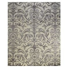 Wool and art silk rug with a scrolling vine motif. Hand-knotted in India.    Product: RugConstruction Material: Wool and art silkColor: WhiteFeatures:  Hand-knottedMade in India Note: Please be aware that actual colors may vary from those shown on your screen. Accent rugs may also not show the entire pattern that the corresponding area rugs have.