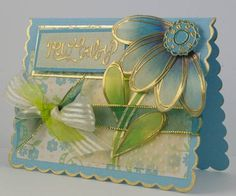 SC186 Baby Blue Flower. Love the gold embossing with the vellum colored on the back side. pick a petal set