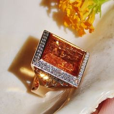 This square orange topaz statement ring, surrounded by diamonds, set in 18k yellow gold with platinum dragonfly design, handmade by Ricardo Basta Fine Jewelry. Can't get enough of this topaz ring