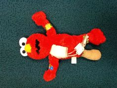 Medical play with Elmo