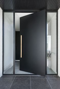 Exterior pivot doors are a perfect way to make a grand entry for any residence or building. Pivot doors can be made fully weatherproof. Modern Entrance Door, Modern Exterior Doors, Exterior Doors With Glass, Modern Front Door, Front Door Entrance, Entrance Decor, Front Door Design, Glass Front Door, House Entrance
