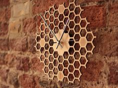"Hexagonal-Open bamboo honeycomb clock. Product Dimensions: 26cm x 26cm x 0.4cm (10.25"" x 10.25"" x 0.16"") This laser-cut hexagonal-open bamboo clock"