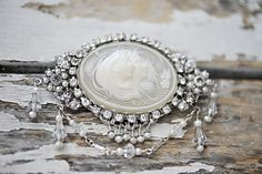 Cameo pin by Erica Koesler. Photography by Stephanie Baker Photography for Bridal Couture Magazine