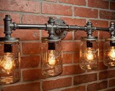A handmade industrial chic two light sconce that is sure to add a truly charming accent to any home. This unique and re-imagined blend of metal pipe