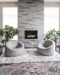 Artistic Tile I The approaching cold has us craving a cozy hideaway, like this texture-rich living room by Jaime Walters Interiors, featuring our Ambra dimensional stone tile. Home Fireplace, Fireplace Remodel, Fireplace Surrounds, Fireplaces, Contemporary Fireplace Designs, Modern Fireplace Tiles, Living Room Designs, Living Room Decor, Tv Wall Decor