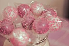 Red velvet cake pops with purple and white coatings and pink sprinkles.