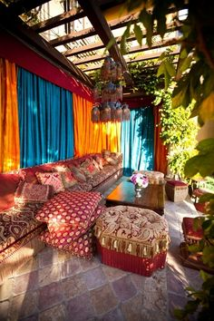 Boho Room, the curtains, the ottomens. <3