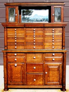 Most of the finish is original & in excellent condition, just cleaned. The three flat top surfaces have been refinished to match the original finish on the rest of the cabinet.