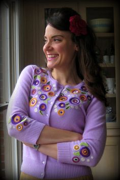 From Cassie Stephens' blog. She had a hole in the sweater and her solution was to felt a circle to hide it and added more circles to transform the boring sweater to super cute. Yes she has the tutorial on her blog. I need to learn how to felt asap!