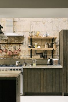 Stone wall as backsplash. Hanging pots above stove and rustic open shelves. LIV for Interiors / Modern Rustic deVOL Kitchen Industrial Style Kitchen, Modern Kitchen Design, Interior Design Kitchen, Rustic Industrial, Rustic Kitchen, Kitchen Designs, Home Decor Kitchen, New Kitchen, Modern Rustic