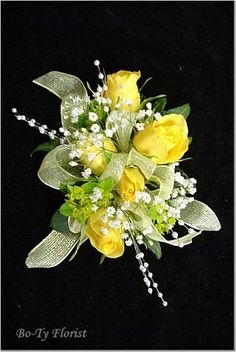 Prom Flowers - Wrist Corsage of yellow roses accented with white pearl sprays and mint green ribbon. Homecoming Flowers, Homecoming Corsage, Prom Flowers, Bridal Flowers, Prom Corsage And Boutonniere, Corsage Wedding, Boutonnieres, Flower Corsage, Wrist Corsage