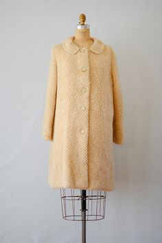 vintage 1960s cream mohair button up coat.  I had a pink one, given to me as a gift.  I hated it.  Wasn't my style.