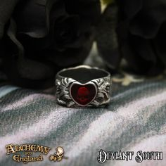 Alchemy Gothic AG-R123 Broken Heart Ring - UK: Q  A pewter band ring featuring on one side a translucent red enamelled heart with a deep-set skull beneath, and on the other, a sculpted skull and roses.