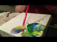In this video I use acrylic paints with a 1 to 1 added floetrol medium. by adding puddles of paint and blowing with a straw I create an exciting abstract flo...