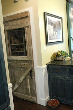 OMG! This is the pantry door I want! Love the chicken wire window!!