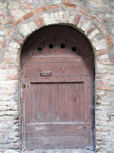 """""""Trouble knocked on the door, but, hearing laughter, hurried away""""   - Benjamin Franklin   (Door in Italy)"""