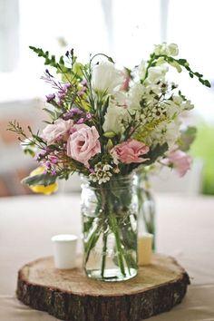 rustic centerpiece idea    For more wedding inspiration check out our blog www.creativeweddingco.com.