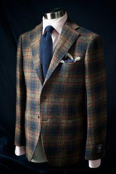 Tweed jacket, pink shirts, blue knit tie