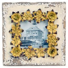 Picture frame with a floral border.   Product: Picture frameConstruction Material: Wood and metalColor:
