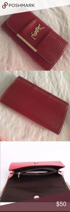 """""""YSL"""" patent leather clutch. Used a couple times only. This was a great bag for weddings! Patent leather / Outside has sight damage to bar on closure. Inside is perfect.  Chain not included (lost in move)   Paid $199 asking $50 Price reflects authenticity.  Looks very nice in person! Bags Clutches & Wristlets"""