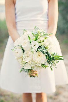 White hydrangeas, creamy garden roses, lisianthus, white ranunculus, herbs and scented geranium.