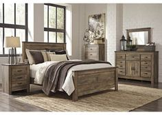 Trinell Queen Panel Bed w/ Dresser, Mirror and Five Drawn Chest, /category/bedrooms/trinell-queen-panel-bed-w-dresser-mirror-and-five-drawn-chest.html