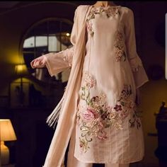 floral embroidery A pastel pink cotton net shirt with affluent floral embroidery, sequins and flamboyant work adorned with beautiful sleeves worked in crystalline ornamental patt Trajes Pakistani, Pakistani Formal Dresses, Pakistani Wedding Outfits, Indian Gowns Dresses, Pakistani Dress Design, Nikkah Dress, Stylish Dress Designs, Designs For Dresses, Stylish Dresses