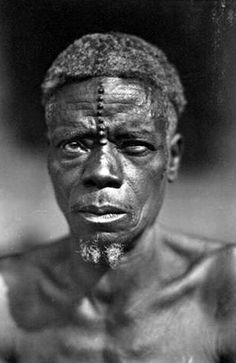 Africa | Man of the M'Bouaka in Province de l'Equateur (now Equator Province, Democratic Republic of the Congo). | © Casimir Zagourski African postcards, 1924-1941 (inclusive). Manuscripts & Archives, Yale University