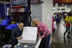 Robin Glassey with Brandon Sanderson at Salt Lake Comic Con 2014 - signing my giant book (the largest autograph he has ever given).