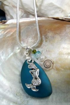 "Mermaid of the Deep Blue Necklace, Beach Glass Pendant, Teal Blue Sea Glass Necklace, Mermaid Jewelry, Ocean Theme Jewelry, Glass Jewelry 24"" chain 1"" x 5/5""  $26.99  Etsy.com"
