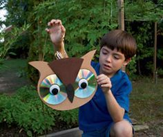 Awesome owl craft, using old CD's. The light reflecting on the CD's scares birds away from your garden!