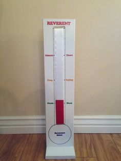 Primary reverent meter. The base is wood with two slots. We sewed a red ribbon and a white ribbon together with Velcro attaching the other ends. You can move it up and down from the back. You'll have the most reverent primary kids!
