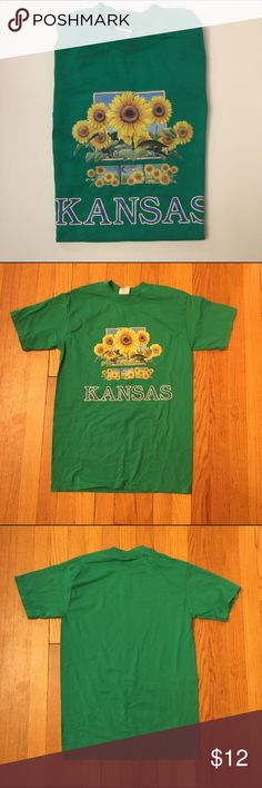 """Vintage Kansas Sunflower Tee 90s tourist tee from Kansas. Green with sunflower design and """"KANSAS"""" on front; plain back. The N in Kansas is slightly faded but it adds to the 90s character. Excellent condition otherwise. Size small fits true. Tops Tees - Short Sleeve"""
