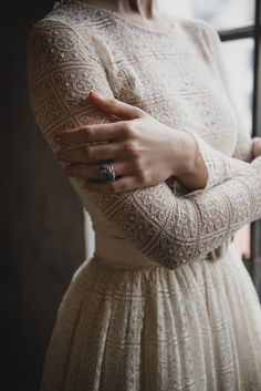 . The subtle color of ivory or cream or beige....speaks softly but has such a presence. I love the combination of the soft color that does not roar and the nubby texture of the crochet. This is a masterful shirtwaist style!