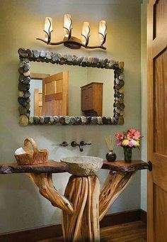 Rustic bathroom This is really cool looking. Not very usefull w/out a cabinet or drawers but very cool looking.