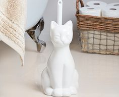 Bring a touch of feline humour into your bathroom or cloakroom with this cat-shaped toilet brush holder.