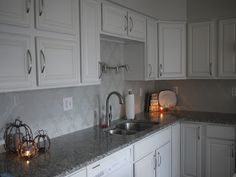 inexpensive backsplash ideas: Stencil it.  Melissa at Pembrooke Lane made a stylish and thrifty backsplash using a free online stencil and Martha Stewart Opalescent paint.  So pretty!