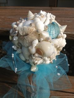 Hey, I found this really awesome Etsy listing at http://www.etsy.com/listing/157058641/turquoise-aqua-bouquet-seashell-bouquet