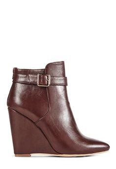 """Grab a pair of JustFab wedge booties in this season's """"it"""" color - burgundy."""
