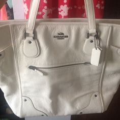 Coach Mickey Tote Cream colored leather tote - BRAND NEW - never used- received as a gift and won't use. It has a deep zipper pouch inside and a zippered pouch on the front center as show. Coach Bags Totes