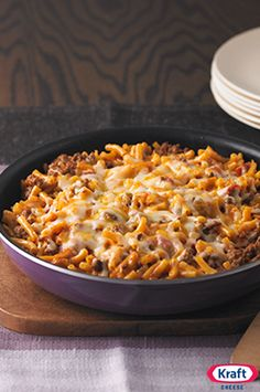 Cheesy Macaroni Beef Skillet - When dinnertime starts with ground beef and a box of mac and cheese, how can you go wrong? This cheesy skillet is destined to become a weeknight staple.