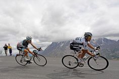 Alberto Contador (right) and Andy Schleck speed down Galibier pass during the 19th stage on their way to Alpe d'Huez on July 22, 2011.