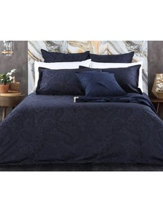 Domani's Rialto presents a modern take on a classic design. The 100% Cotton Yarn Dyed Jacquard is graced by a black intricate woven pattern on a navy base. Pair with the Gianni cushion and Aran throw in ink to create a truly dramatic look (sold separately).