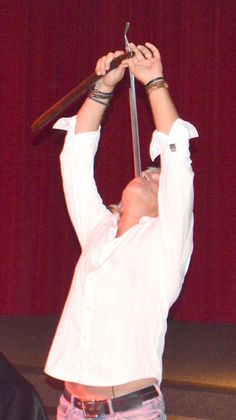 Though known for swallowing swords, Dan Meyer also swallows sharp utensils! #ShowsThatWow  For Schedule & Booking Info: www.WOWAttractions.com