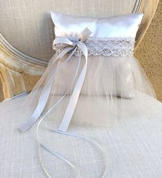 Silver satin ring pillow wrapped in a delicate sequined lace. Pillow is given an adorable gray tulle tutu skirt and embellished with a gorgeous