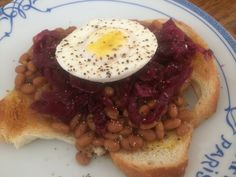 Something simple, yet tasty and satisfying.  Homemade bread, toasted, with baked beans, raw sauerkraut, and a beautiful poached pastured egg.